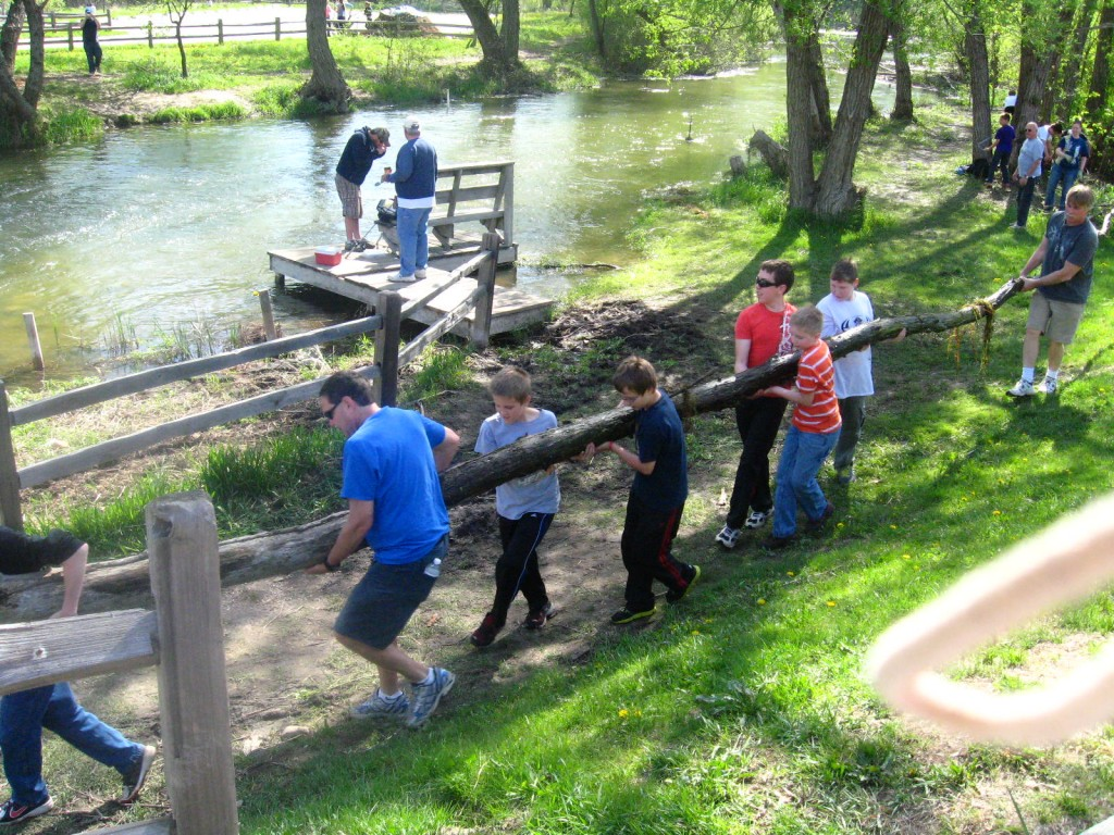 6th graders remove debris from the river.